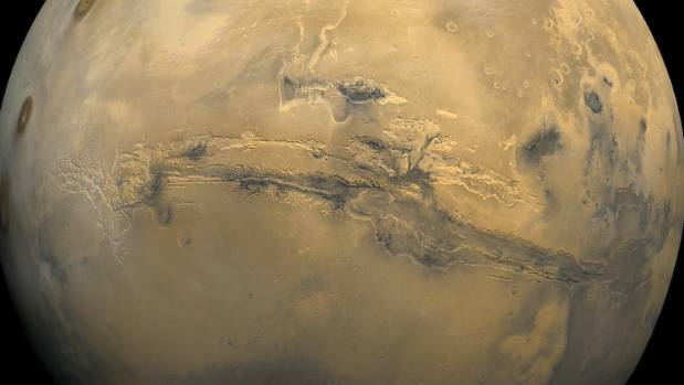 The largest canyon in the solar system runs across the surface of Mars. Valles Marineris, the grand valley, extends over ...