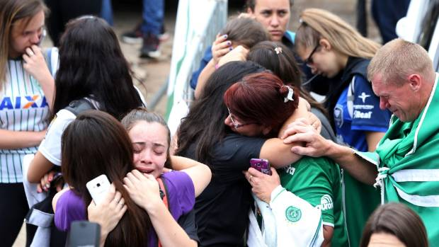 Fans gather outside the Arena Conda stadium in Chapeco after hearing the news.