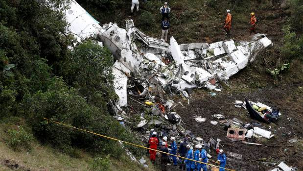 Rescue crews work on the wreckage of the plane in the Colombian jungle.