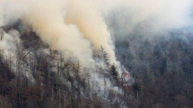 Smoke plumes from wildfires are shown in the Great Smokey Mountains near Gatlinburg.