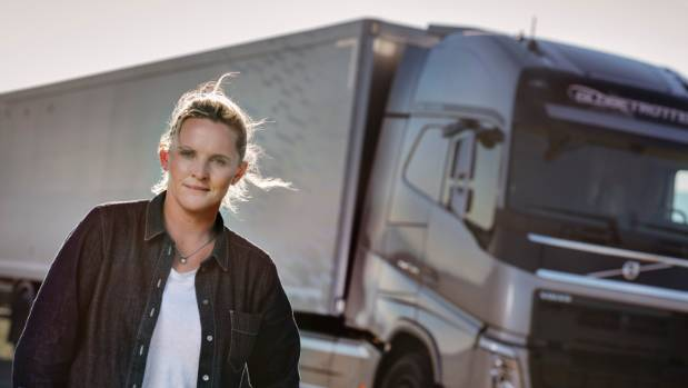 Kiwi truck driver Louise Marriott in front of the Volvo truck she towed a paraglider with through an underpass in Croatia.