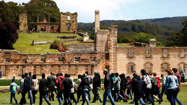 Tourists are led by a guide as they walk around the historical town of Port Arthur, located southeast of the capital ...