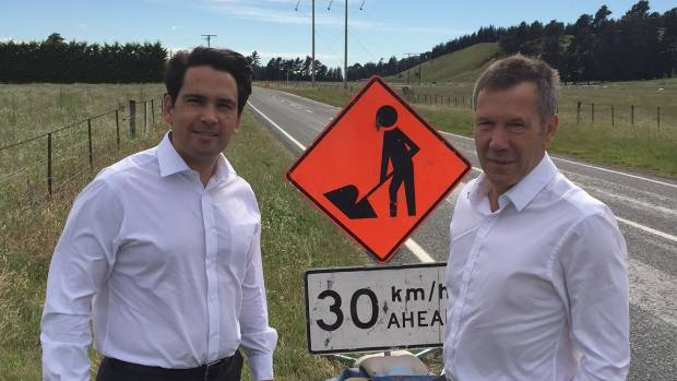 Transport Minister Simon Bridges, left, and Kaikoura MP Stuart Smith inspect the condition of State Highway 63 on Tuesday.