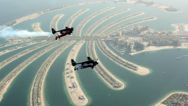 An aerial view taken from a sea plane shows Swiss pilot and original Jetman Yves Rossy (front) and Vince Reffett flying ...