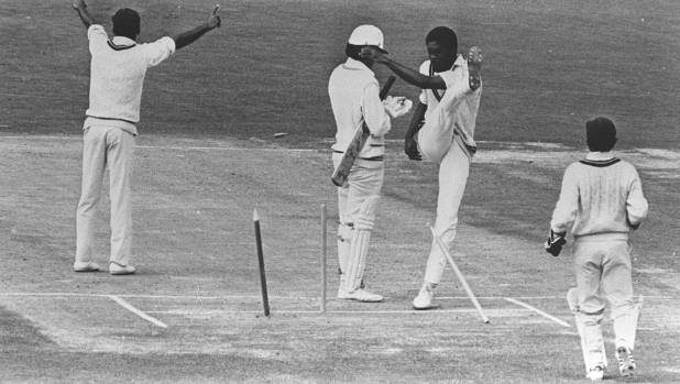 Michael Holding splays the stumps, though not in his usual manner, after a debatable umpiring decision goes against the ...
