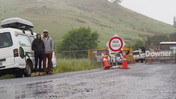 Tourists Colin Martin and Kelsey Nolan wait at the Inland Road cordon hoping to get out of Kaikoura to continue their ...