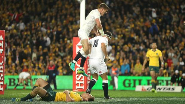 Owen Farrell and Jamie George celebrate downing the Wallabies in Sydney in June.