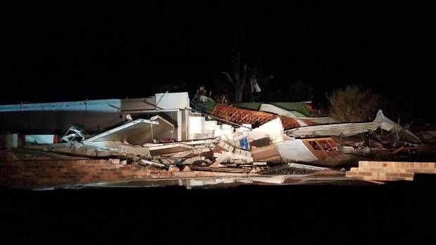 A building destroyed by tornado in Rosalie, Alabama on early Wednesday.
