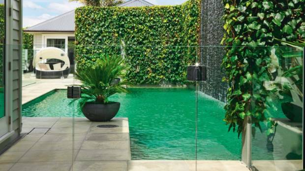 Create a plush resort-feel by planting vertically beside the pool.