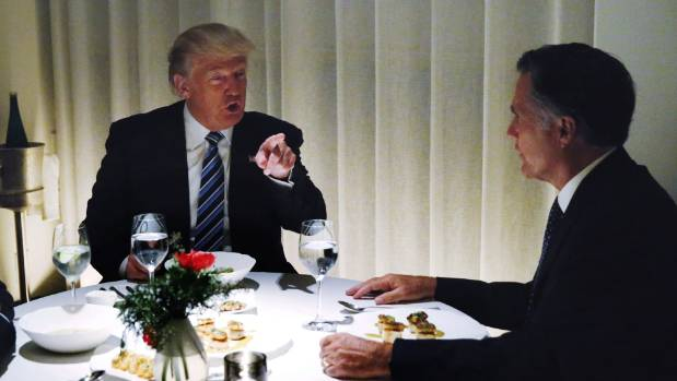 US President-elect Donald Trump met with former Massachusetts Governor Mitt Romney at his Trump International Hotel on ...
