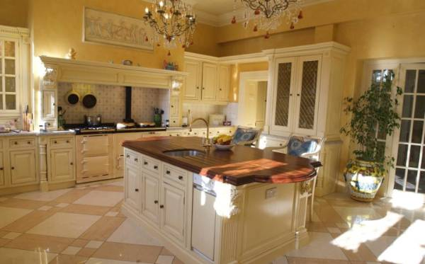Traditional cabinetry is a feature of the large family kitchen.