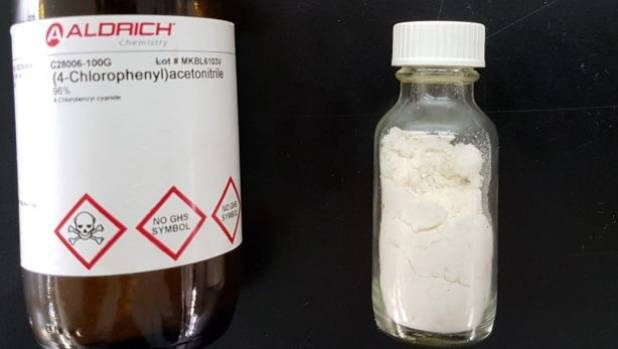 The raw material 2,4-chlorophenyl acetonitrile (left) can be synthesised into pyrimethamine (Daraprim). The sample on ...