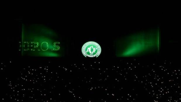 Mobile phone flashlights are used by fans to pay tribute to Chapecoense Real players killed in Monday's plane crash in ...