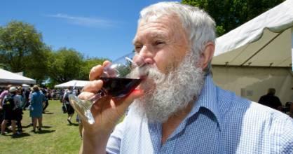 Nigel Hampton QC enjoying a glass of red wine.