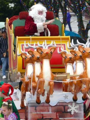 Santa thrills the crowd at the Southland Santa Parade.
