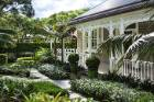 The multilayered garden guiding visitors to the front door of the Waymouth family's gracious Herne Bay villa is an ...