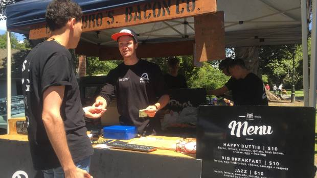 Bacon Bros owner Troy Bilbrough with a customer at the Christchurch Farmers' Market.