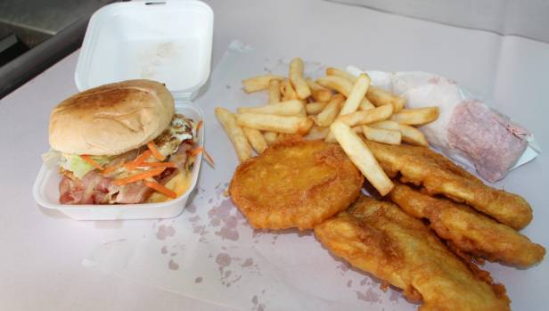 Our order included the works burger, a corn fritter, hot dog, battered snapper, kumara fritter and chips. Taupiri Takeaways, Waikato district.