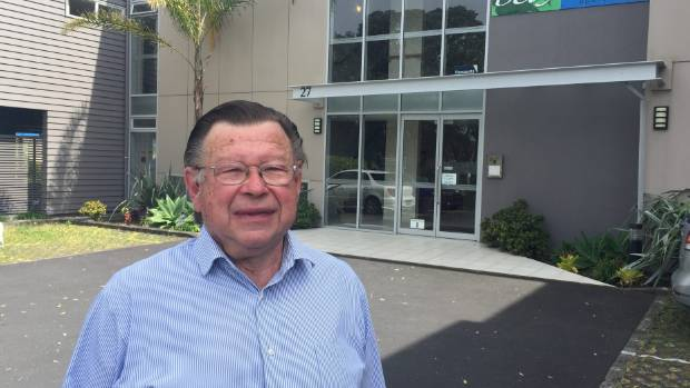 Grey Power Auckland director Bill Rayner outside the Browns Bay Bay Palms apartments - whose residents he has serious ...