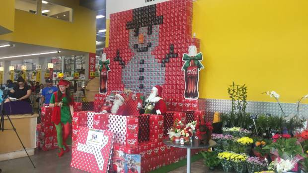 The snowman display made out of Coca-Cola products surrounds Santa's meet and greet area at Pak 'n Save Clarence ...