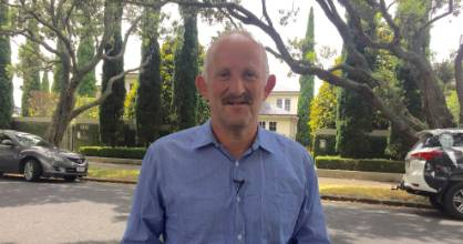 "Gareth Morgan chose to announce his taxation policy outside John Key's ""mansion"" in Parnell, Auckland, on Wedneday"