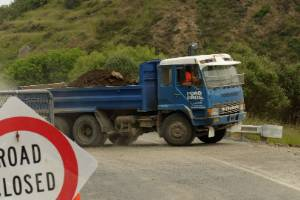 Ford Brothers trucks ferrying debris away from the SH1 slips south of Kaikoura on Wednesday.