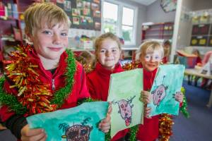 Ward School pupils, from left, Louis Hickman, 6, Victoria Hickman, 5, and Courtney Edwards, 6, show their Christmas ...