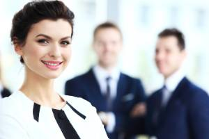 08122016. Photo: 123rf.com Face of beautiful woman on the background of business people