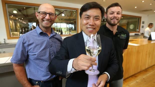 Cloudy Bay vineyard manager Peter Lamb, Chinese Consul-General Jin Zhijain, and Cloudy Bay assistant viticulturist Matt ...