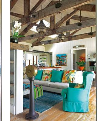 Kerry has added her signature colours - turquoise, orange and lime green - in the furnishings; the Morroccan lanterns ...