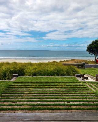 The north-facing view from the front deck takes in the Great and Little Barrier islands and the tip of the Coromandel ...