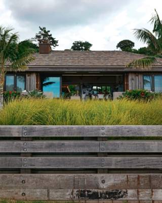 "A ""lawn jetty"" against the front of the house raises the landscape above a flood plain."