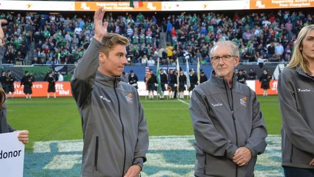 Kidney transplant patient Matthew Field, left, at Soldier Field, Chicago, during the All Blacks vs Ireland rugby game in ...