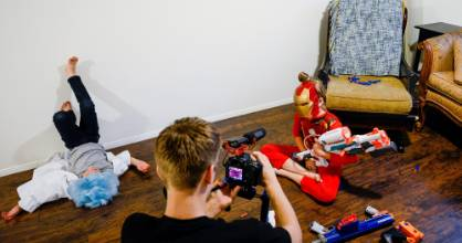 Zane Nixon, 19, films Hope as Noah Nixon, 7, waits for his turn on camera. The Nixons created 'SuperHeroKids' as a ...