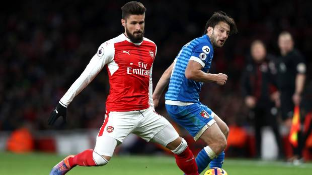 Arsenals Olivier Giroud Left And Bournemouths Harry Arter Tangle For Possession In A Premier