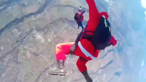 Professional skydiver Enrico Marcucci dressed as Santa Clause and handed out gifts and sweets to the children.