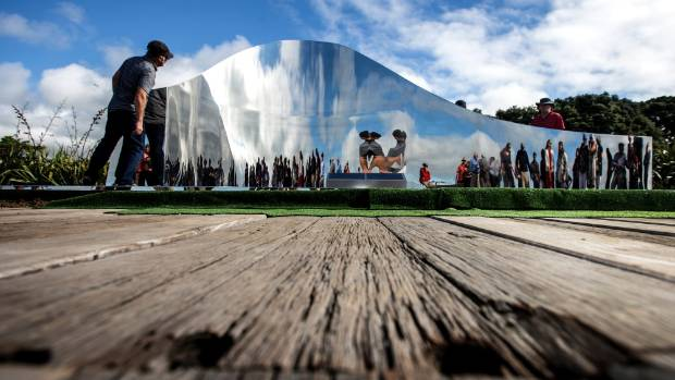 A captivated audience of about 80 people watched as New Plymouth's latest piece of public art was revealed on Friday.
