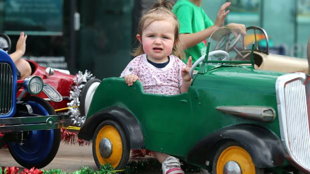 Charlee Rawson catches a lift at the Christmas Parade on Saturday.