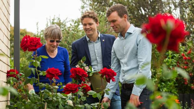Iola Davies showing a few of her rose growing techniques to Student Volunteer Army founder Sam Johnson, centre, who has ...