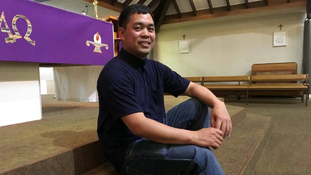 Rev. Fredy Permentilla at St Thomas Aquinas church in Winton. About 150 people attended the Filipino Mass on December 9.