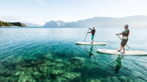 Paddleboarding on Lake Wanaka.