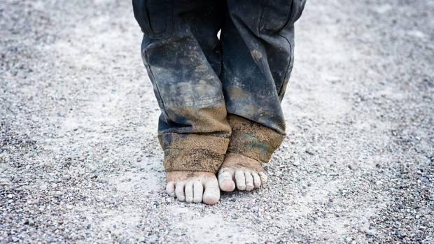 12 ECONOMICS CHILD POVERTY - Magazine cover