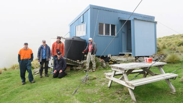 A Marlborough Tramping Club expedition to inspect the Hodder Huts, from left, pilot Simon Cooke, Kerry Millard, ...