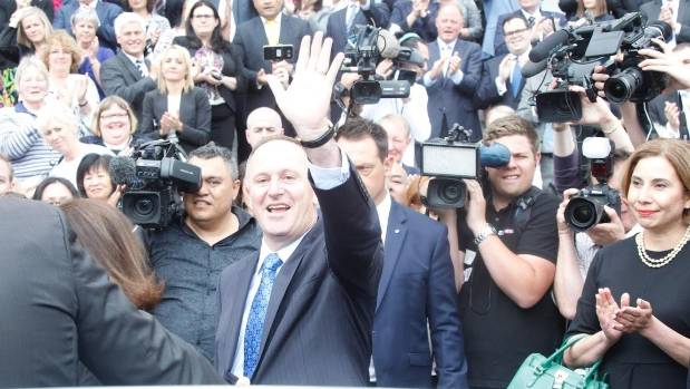 Key waves to the crowd after stepping down as Prime Minister.