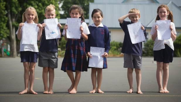 Marian Catholic School kids show off their letters to Santa. (from left) Heidi Maarhurs, Carter Wisenewski-Rowe, Ava ...