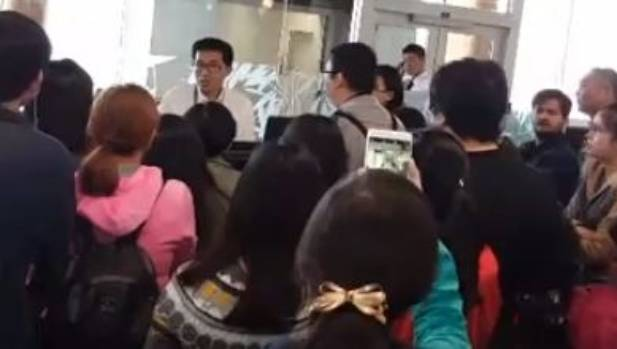 """Mob"" of angry passengers demand answers after flight is delayed twice in two days."