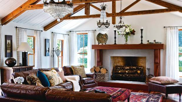 With a glamourous fireplace like the one pictured in this Kapiti coast home, it would be worth relegating the television ...