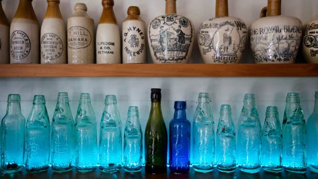 Vaughan Morresey reckons his bottle collection is worth about $20,000.