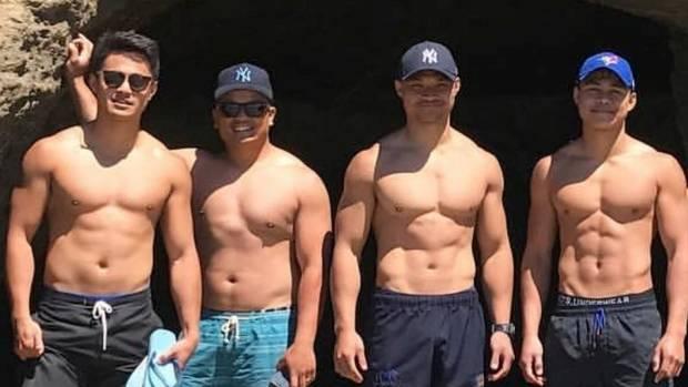 Josh Nicodemus, left, with fellow Fillipino player Carmilo Manuyag and brothers John and Jericho.