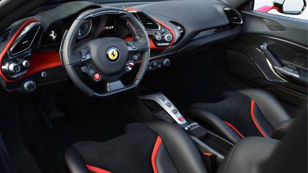 The red-over-black interior trimmed in fine leather and Alcantara of the Ferrari J50.